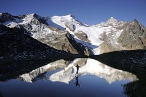 Tightrope: Heinz Zak on a highline across a lake in Stubai, Austria