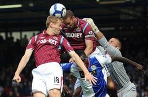 premier league: Matthew Upson and Jonathan Spector head the ball clear