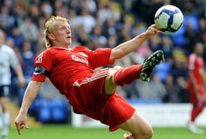 premier league: Liverpool's Dirk Kuyt clears the ball