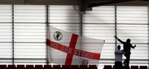 premier league: Stoke City fans put up their flag amongst the empty seats