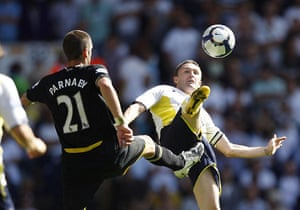 premier league: Spurs' Robbie Keane and Birmingham's Stuart Parnaby high kick for the ball