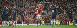 Prem 2: Rooney celebrates amongst dejected Arsenal players