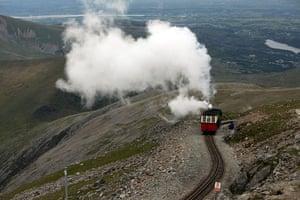 Snowdon visitor centre: The Snowdon steam mountain railway makes its way to the summit of Snowdon
