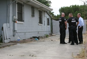 Jaycee Dugard kidnapping: Police officers stand in front of the home of Phillip Garrido
