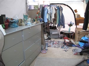 Jaycee Dugard kidnapping: Clothes hanging on a rail in front of taped repairs to the tent