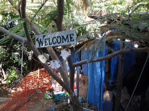Jaycee Dugard kidnapping: A painted Welcome sign and wind chimes on a tree in the backyard