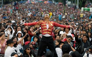 24 hours in pictures: Mexico City, Mexico: Hector Jackson takes part in a mass Thriller dance