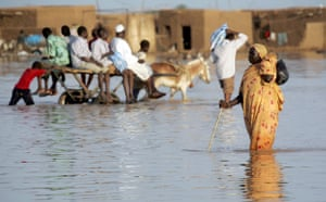 24 hours in pictures: Khartoum, Sudan: A Sudanese woman walks through a flooded road