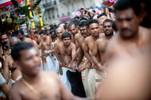 24 hours in pictures: Paris, France: People parade to celebrate the Hindu deity Ganesh