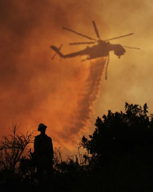 24 hours in pictures: La Canada Flintridge, US: A firefighter watches a water drop
