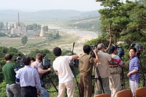 Korea and the US: 2008: TV crews film the demolition of the Yongbyon nuclear cooling tower