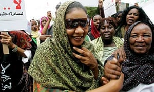 Lubna Hussein is greeted by supporters outside the court in Khartoum