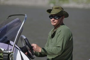 Putin on vacation: Russian Prime Minister Vladimir Putin drives a motorboat on vacation