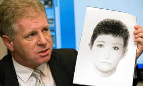 McCann family spokesman Clarence Mitchell holds up a photo-fit of a woman