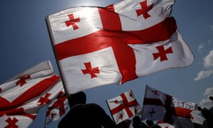 Georgians wave their national flag