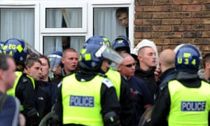 Residents watch as police deal with rightwing activists in London during clashes with anti-fascists
