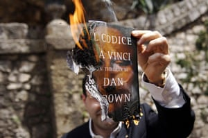 "Dan Brown latest novel: : The cover of a copy of Dan Brown's ""The Da Vinci Code"" after set on fire"