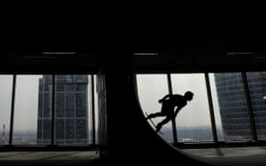 24 hours in pictures: skateboarder in Moscow City business complex