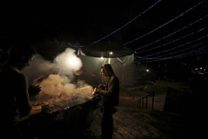 24 hours in pictures: Jerusalem: Palestinians buy kebabs before sunrise during the Ramadan