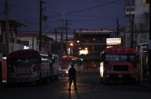 24 hours in pictures: Ciudad Juarez, Mexico: A soldier guards a crime scene