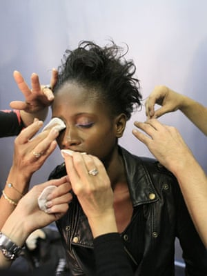 24 hours in pictures: A model gets ready  during New York Fashion Week