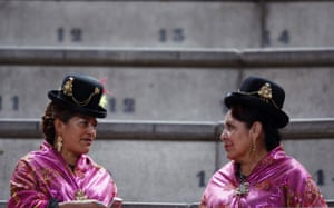 24 hours in pictures: Bolivian women wait for the arrival of President  Evo Morales in Spain