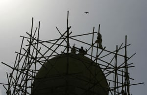 24 hours in pictures: Construction workers set a bamboo scaffolding in Karachi