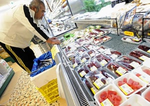 Dolphins in Japan: A man looks at the dolphin meat and other sashimi products at a supermarket