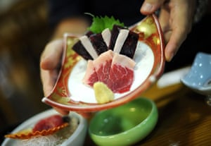 Dolphins in Japan: Whale meat sashimi is served with fresh ginger at a hotel in Taiji