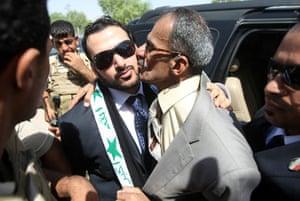 al Zaidi released: Muntazer al-Zaidi  is kissedby his uncle following his release