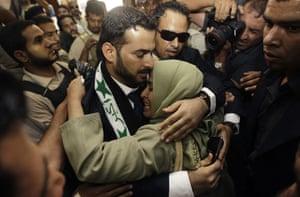 al Zaidi released: Muntazer al-Zaidi embraces his sister  following his release from prison