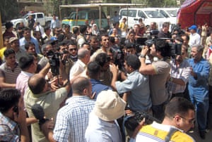 al Zaidi released: Muntazer al-Zaidi surrounded by the press