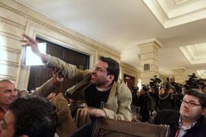 al Zaidi released: Muntazer al-Zaidi throws his shoe at George W. Bush