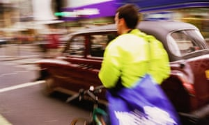 Bike blog: Bicycle courier riding in traffic