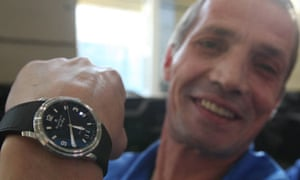 Russian metalworker Viktor Zagaevsky with a watch given to him by Vladimir Putin