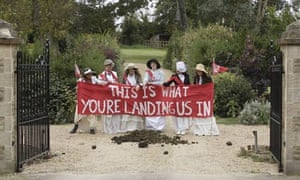 Protesters from Climate Rush dump bags of horse manure on Jeremy Clarkson's driveway