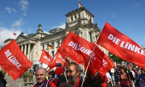 Supporters of Die Linke hold an anti-nuclear protest near the Reichstag