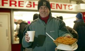 Football fan eating pie