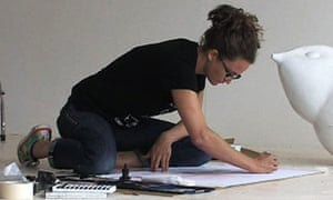 An artist at work in her studio