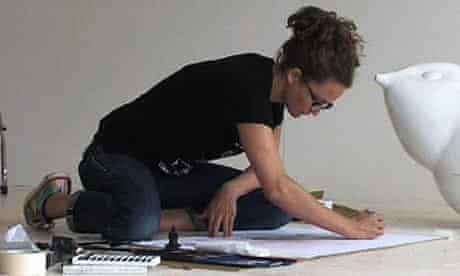 An artist at work in her studio