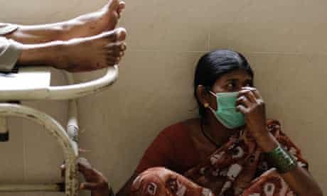 Woman wearing mask to protect against swine flu, India