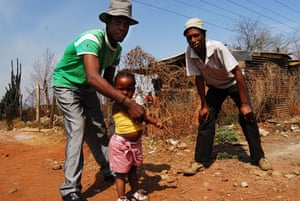 Chiawelo in Soweto: Earnest Molefe, right, and Vusi Mtembo with his little daughter Thembi