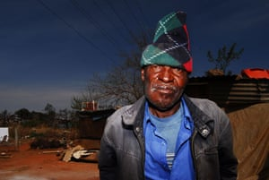 Chiawelo in Soweto: Justice Mafisa stands in front of his shack. He does not want to move