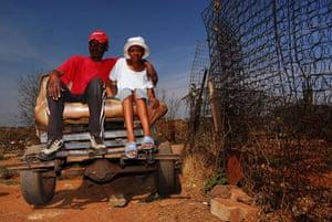 Chiawelo in Soweto: John Nekhumbe and Raylene Magoro sit in his 'donkey cart'