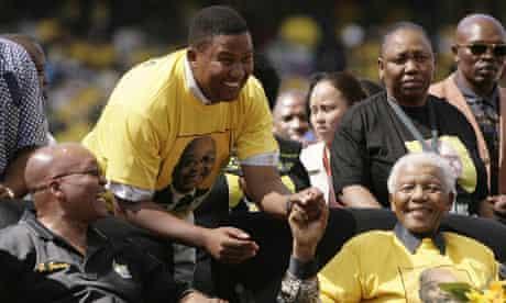 Nelson Mandela jokes with his grandson Mandla