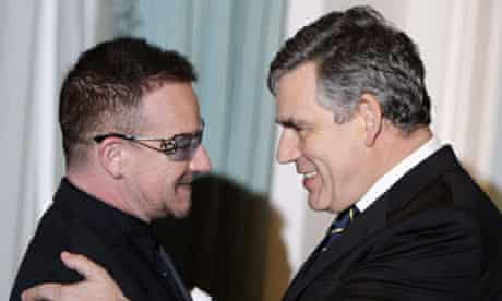 Gordon Brown is congratulated by Bono in New York