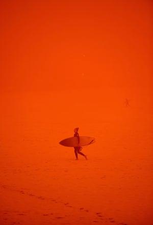 Sydney dust storm: A surfer at Bondi Beach