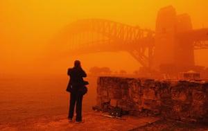 Sydney dust storm: A photographer takes pictures of the Sydney Harbour Bridge