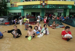 Philippines floods: Filipinos plead for help as they evacuate a flooded hospital in Cainta