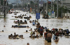 Philippines floods: Residents wade in floodwaters in Cainta Rizal east of Manila